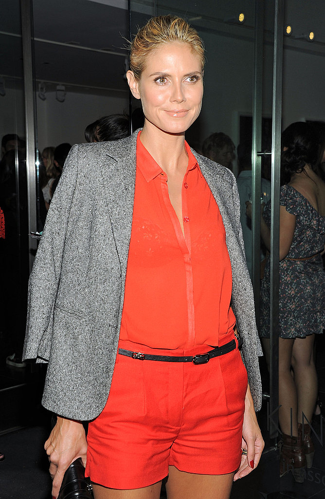 Heidi Klum brightened up the gallery in bright orange.