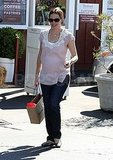 Pregnant Jennifer Garner in a pink top.