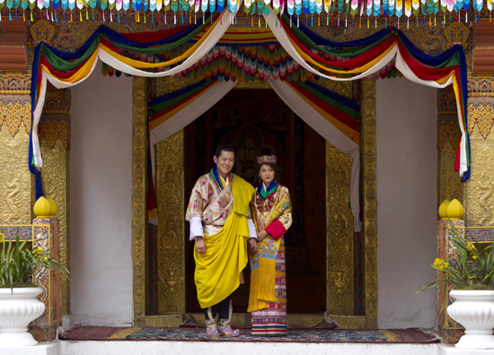 King Jigme Khesar Namgyel Wangchuck and Queen Ashi Jetsun Pema walk out after their wedding ceremony.