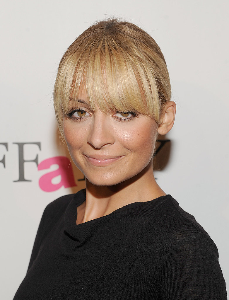 Nicole Richie with blond bangs.