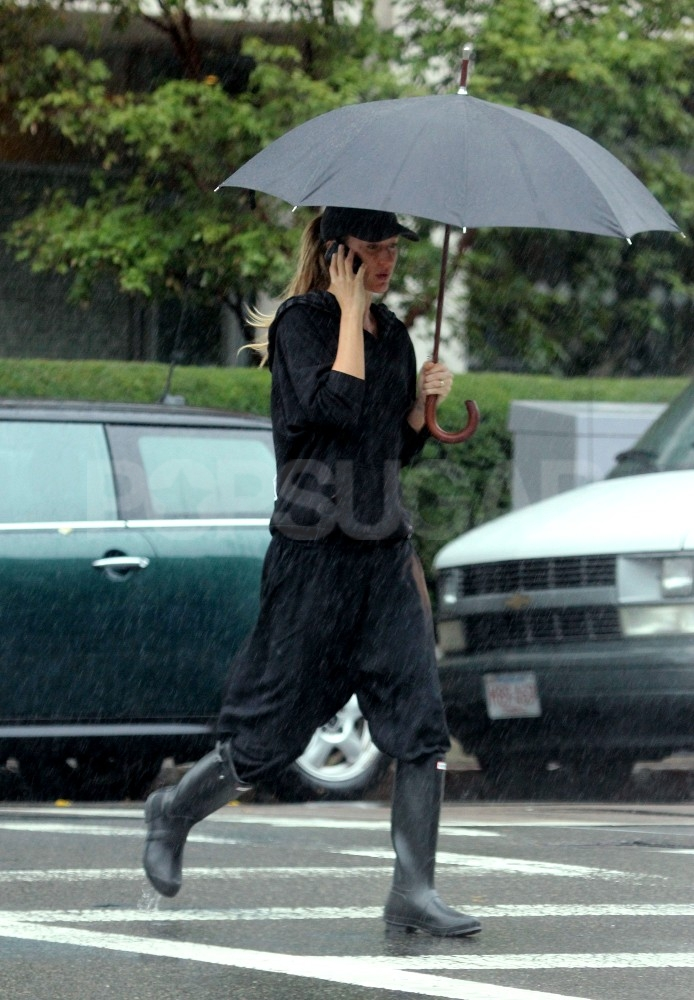 Gisele Bundchen made a phone call in the rain.