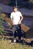 David Beckham hung out by a fence.