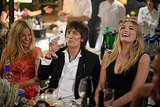 Sienna Miller, Ronnie Wood, and Lily Donaldson chatted at dinner.