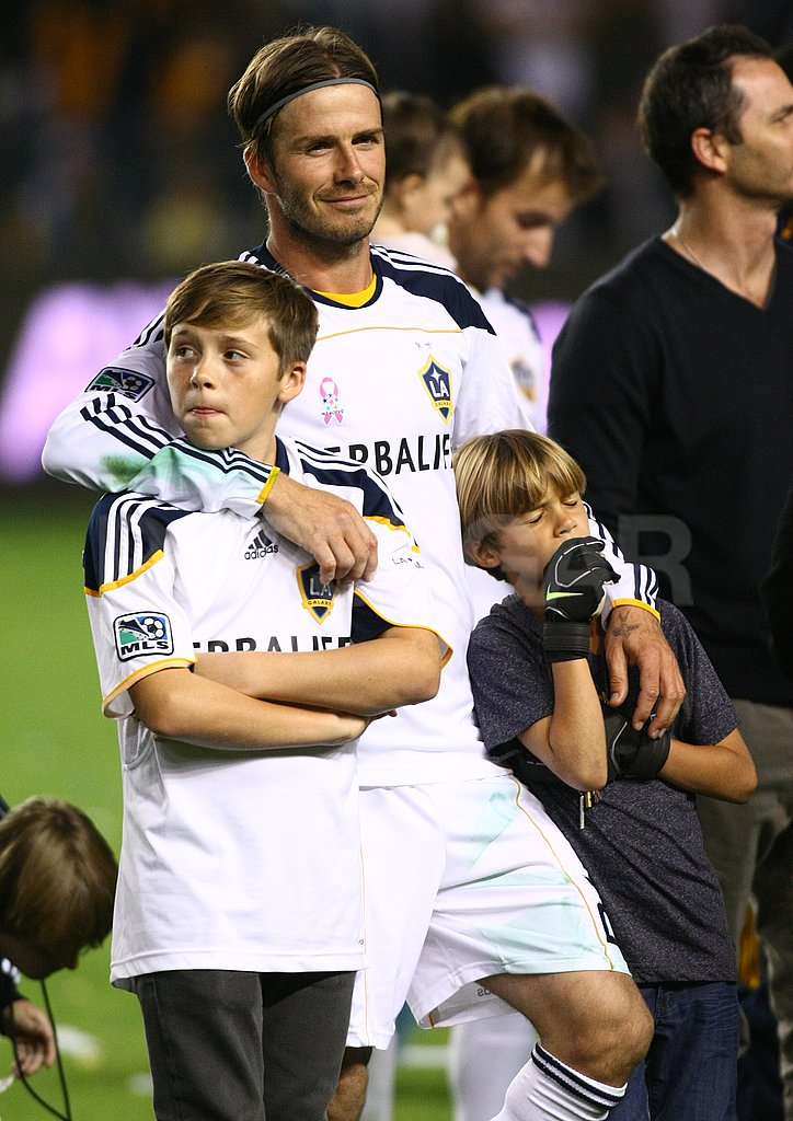 David Beckham held onto his sons Brooklyn and Romeo.