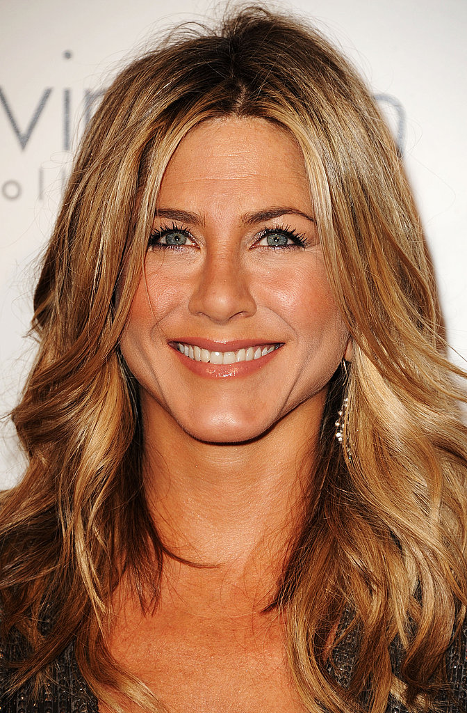 Jennifer Aniston smiled brightly for an event at Elle.