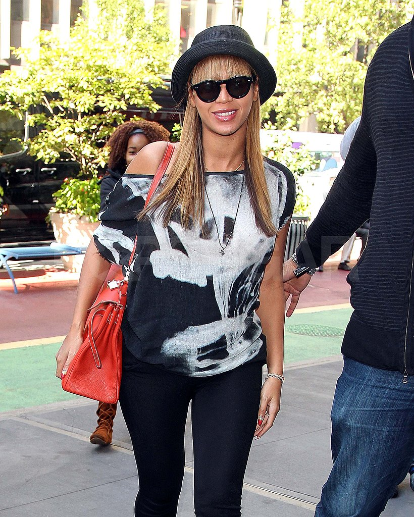 Pregnant Beyoncé with bangs.