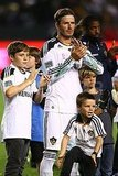 David Beckham applauded his opponents with his sons Brooklyn, Cruz, and Romeo.