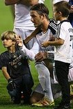 David Beckham talked to Romeo and Cruz after his soccer game in LA.