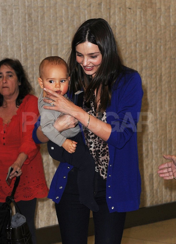 Miranda Kerr held adorable Flynn Bloom close at JFK.