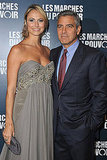 George Clooney poses with Stacy Keibler at the Paris premiere of The Descendants.