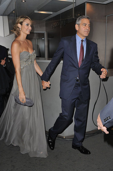 George Clooney and Stacy Keibler hold hands at the Paris premiere of The Descendants.