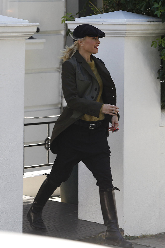 Gwen Stefani wore tall boots and a newsboy cap.