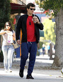 Orlando Bloom enjoyed a midday beverage.