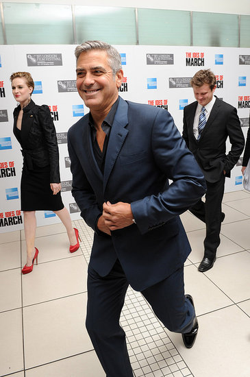 George Clooney laughs in London.