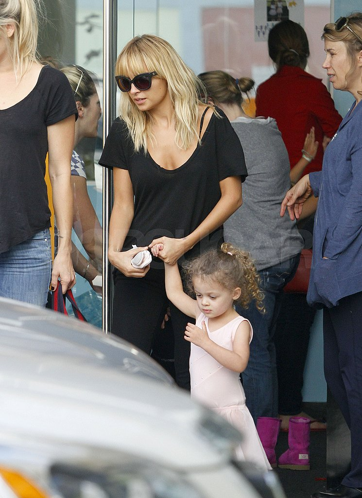 Nicole and Harlow held hands.