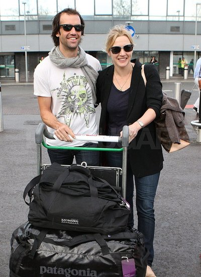 Kate and Ned pushed their luggage outside the terminal.