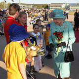 Queen Elizabeth greets school children.