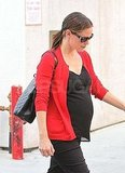 Jennifer Garner with baby bump in red sweater.