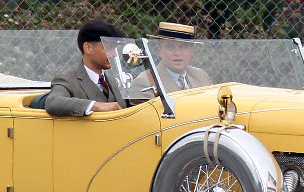Leonardo DiCaprio and Tobey Maguire filming The Great Gatsby in a fancy car.