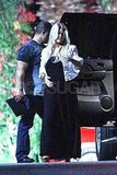 Pregnant Jessica Simpson holds her stomach in Palm Springs.