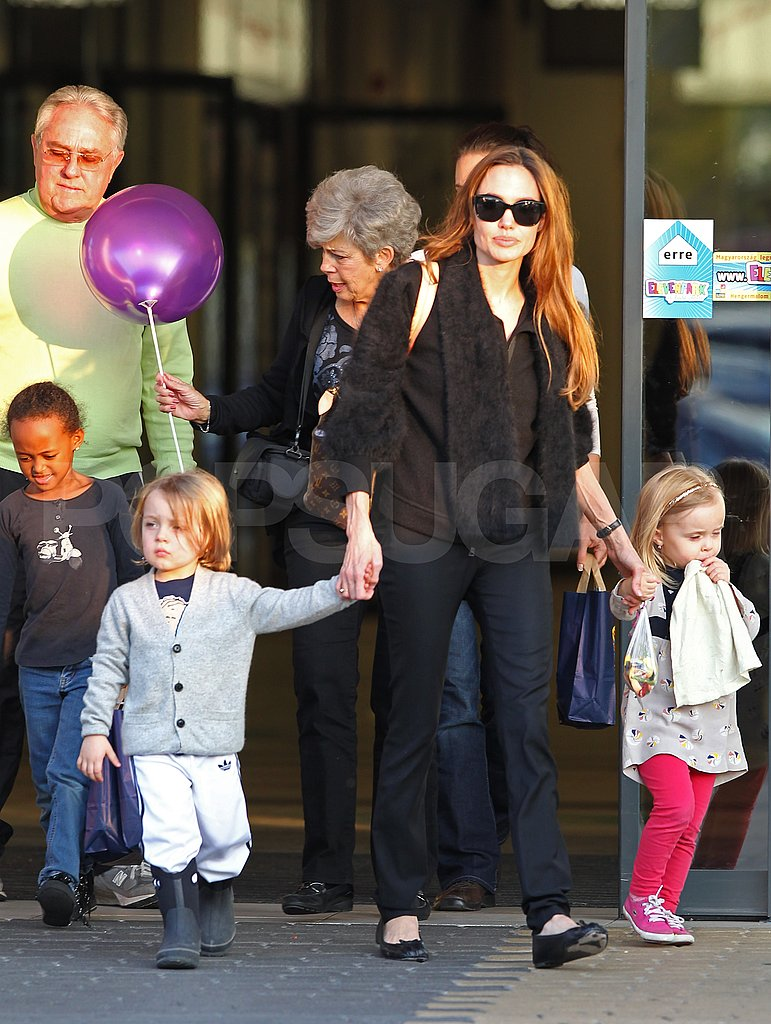 Angelina Jolie left a Budapest children's center with Zahara Jolie-Pitt, Knox Jolie-Pitt, Vivienne Jolie-Pitt as well as Brad Pitt's parents Jane and Bill.