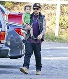Joel Madden carried Sparrow Madden to the pumpkin patch.