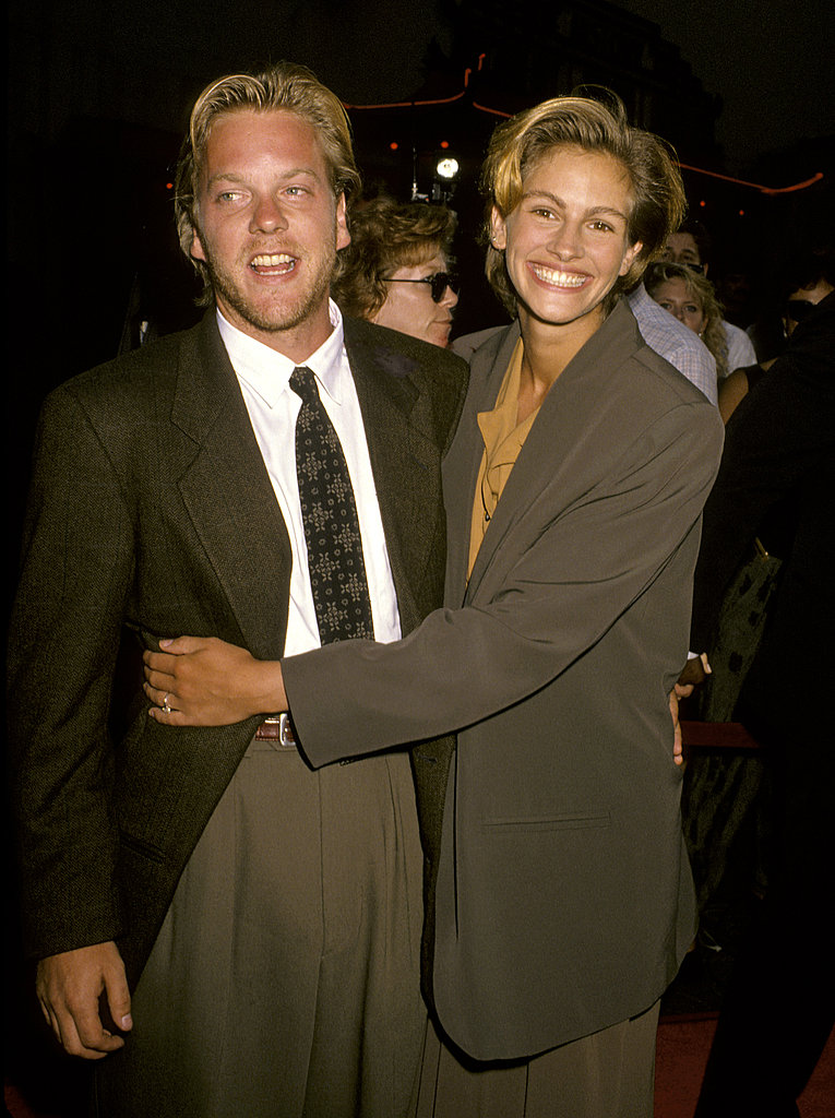 Julia Roberts smiled and snuggled with then-fiancé Kiefer Sutherland at the Young Guns II premiere in 1990.