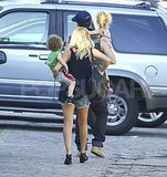 Nicole Richie held onto Sparrow Madden while Joel Madden carried Harlow Madden.