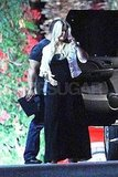Jessica Simpson in a black maxi dress.