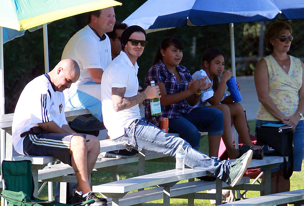 David Beckham got comfortable on the bleachers at his sons' soccer game.