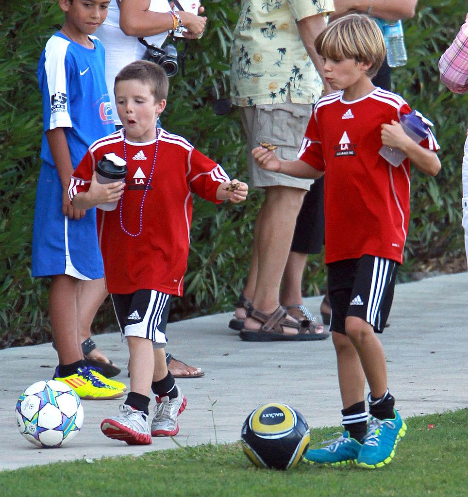Cruz Beckham and Romeo Beckham dribbled their soccer balls home after a game.
