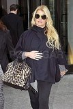 Jessica Simpson in black cape.