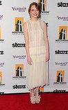 Emma Stone wore a pale dress to the Hollywood Film Awards Gala.