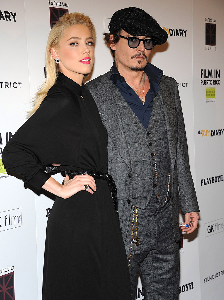 Johnny Depp put his arm around Amber Heard for photos.