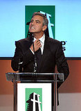 George Clooney pretended to loosen his neck tie.