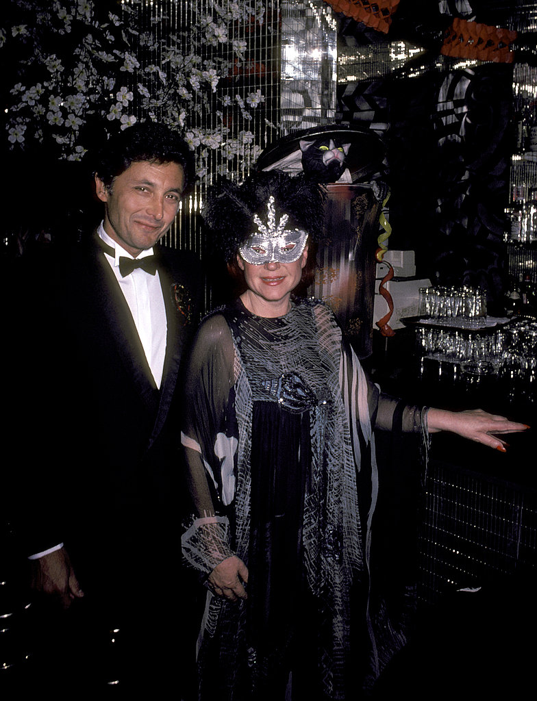 "Many of the most glamorous Halloween parties took place at clubs owned by Régine Zylberberg, who invented the modern concept of the nightclub. The French singer, nicknamed the ""Queen of the Night,"" is pictured here with her second husband Roger Choukroun at one such soiree in 1980."