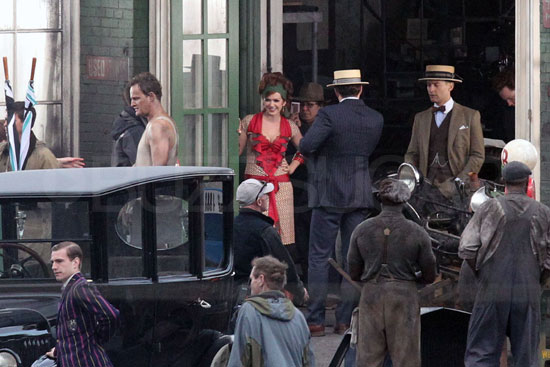 Tobey Maguire as Nick Carraway, Joel Edgerton as Tom Buchanan, and Isla Fisher as Myrtle Wilson on the set of The Great Gatsby.