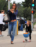 Alessandra Ambrosio and Anja Mazur pushed pumpkins down the street in LA.
