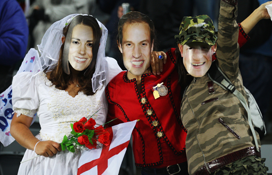 If you want to go all out, take a cue from these rugby fans who are wearing Will, Kate, and Harry masks to complete their royal trio outfits.