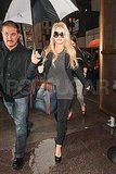 Jessica Simpson covered her likely baby bump in NYC.
