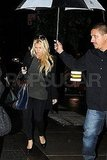Jessica Simpson had help with her umbrella in NYC.
