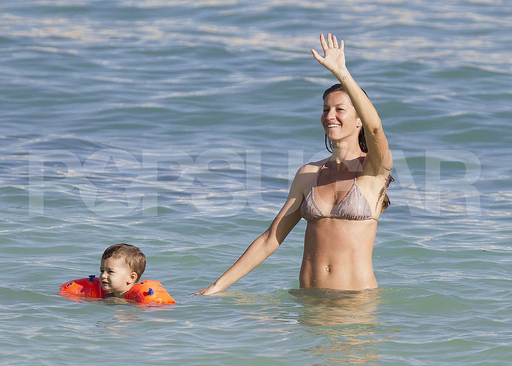 Gisele waved to someone on the shore while Ben tested out his swimming skills.