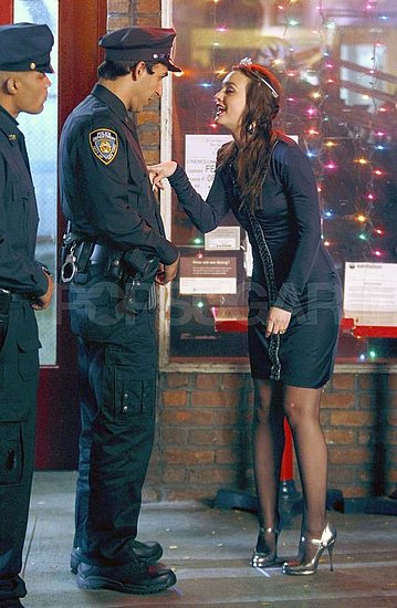 Leighton Meester filming Gossip Girl with a police officer in NYC.