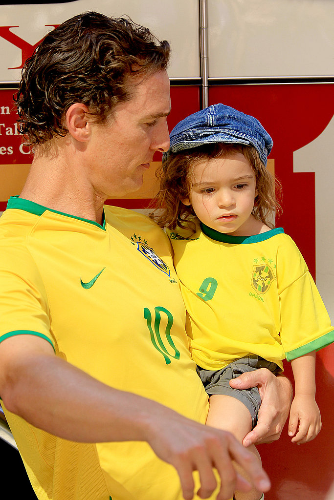 Matthew McConaughey and Levi sported matching yellow jerseys while visiting a firehouse in NYC in June 2010.