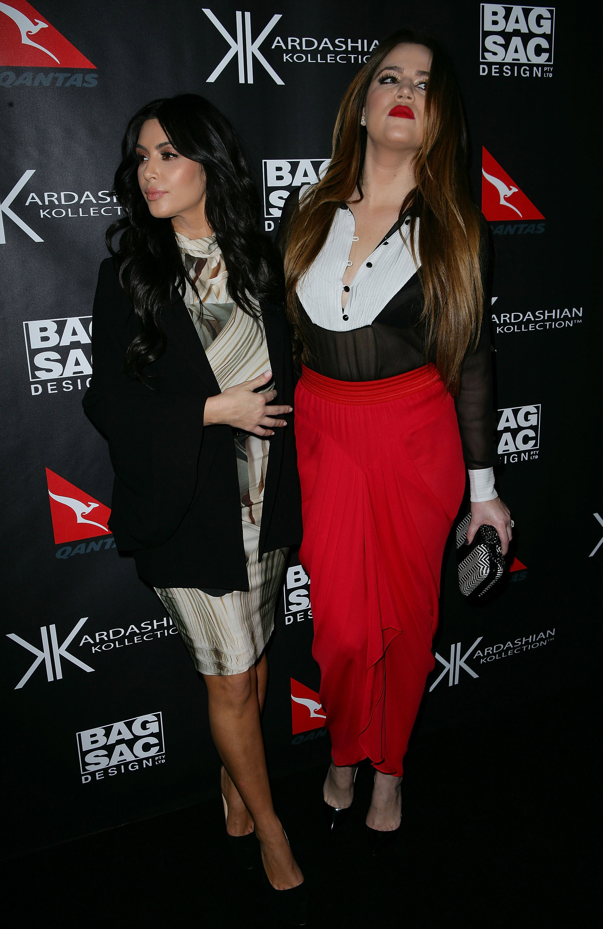 Kim and Khloe Kardashain checked out the scene at their event in Australia.