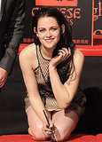 Kristen Stewart held a pen without the bandage she landed in LA with.