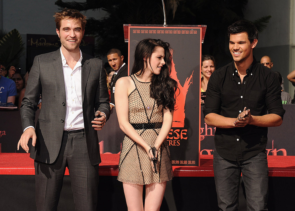 Kristen Stewart, Robert Pattinson, and Taylor Lautner played with the wet cement on their palms.