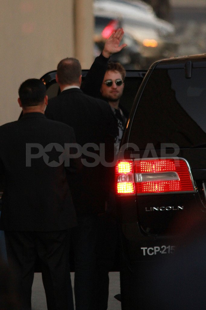 Robert Pattinson waved goodbye to fans in LA.