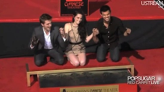 Video: Robert, Kristen, and Taylor Hold Hands For a Fun and Messy Photo Op