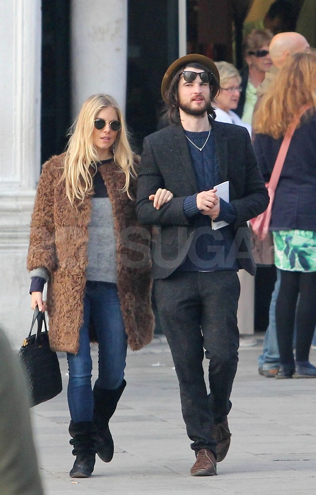 Tom Sturridge lifted up his sunglasses to get a better view.